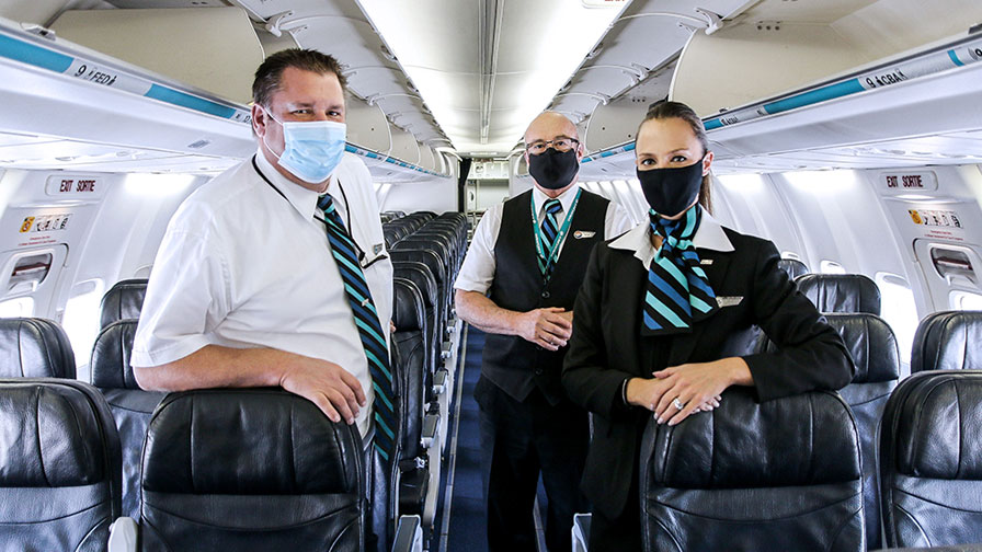 WestJet cabin crew with masks on