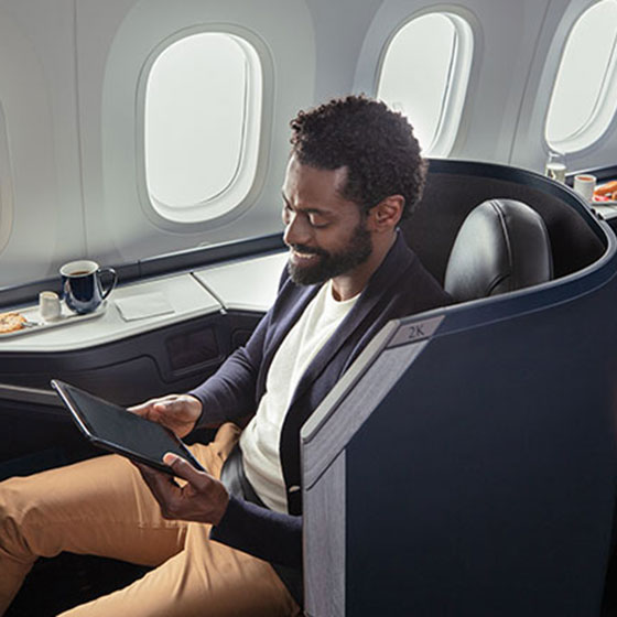 Professional seated in Business cabin pods on the WestJet Boeing 787 Dreamliner.