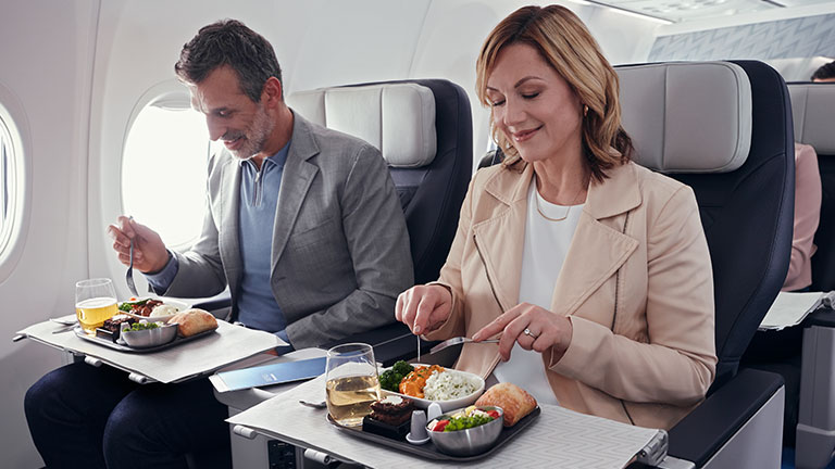 Guests dining in WestJet's Premium cabin onboard the 787 Dreamliner