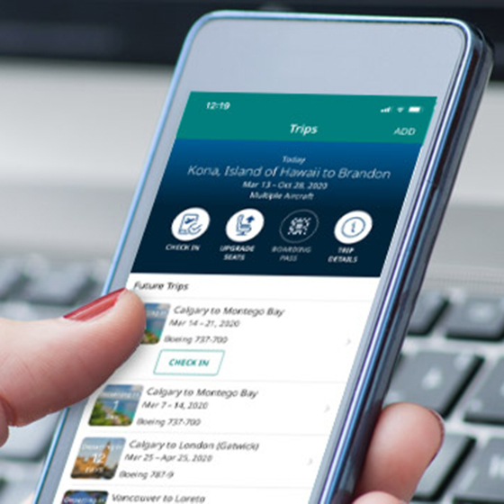 Hand holding phone displaying WestJet App