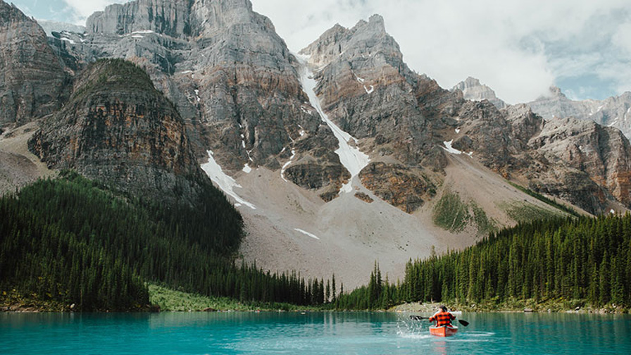Canoeing with majestic mountains in the background