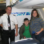 Mother and son with pilot aboard aircraft